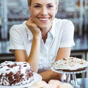 happy-pretty-woman-preparing-plate-of-cake.jpg