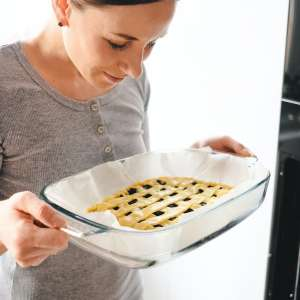 young-woman-puts-the-homemade-cake-in-the-oven.jpg